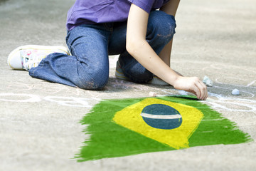 Child drawing Brazil`s flag