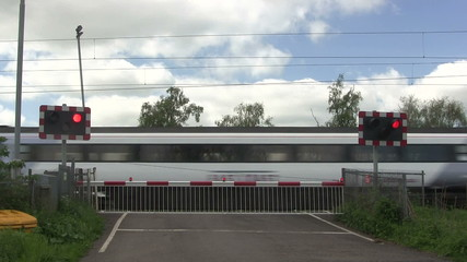 Diesel train crossing a level crossing.