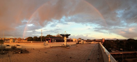 rainbow and satellite dish after storm