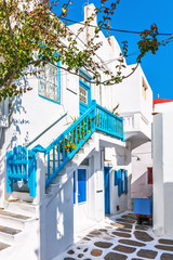 White house with typically colourful balustrade in Mykonos