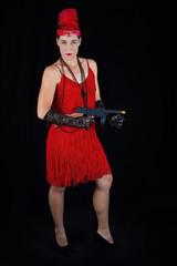 Dangerous beautiful brunette in 1920 style attire red dress feat