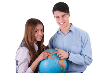 girl and boy with globe. Isolated on white background