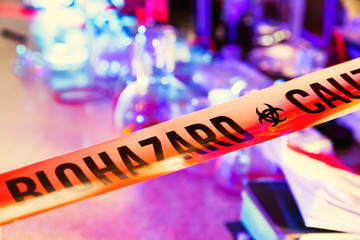 Caution tape in hazardous biochemicals laboratory
