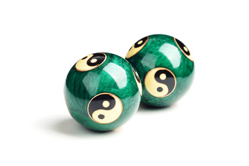 Green Chinese balls for relaxation on white