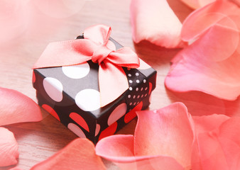 Gift box with bow and petals