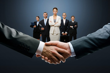 Closing deal with a handshake on business background