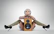 Blonde girl with wooden speaker