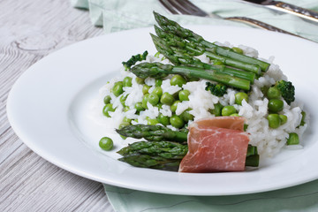 risotto with asparagus and green peas close-up