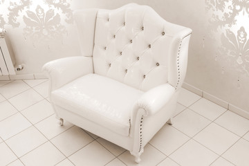 white leather armchair