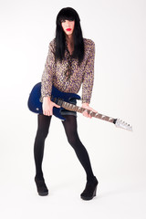 transvestite in heels with electric guitar