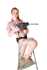 Attractive woman with puncher on ladder