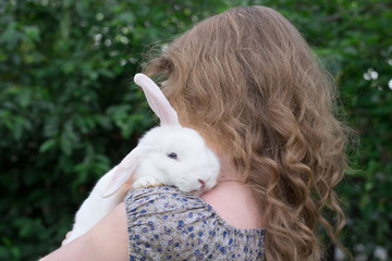 girl with rabbit on hands