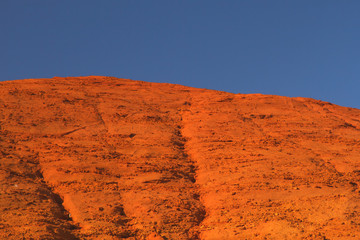 Ocher hill and blue sky.
