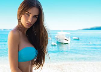 Portrait of brunet beauty in blue swimwear