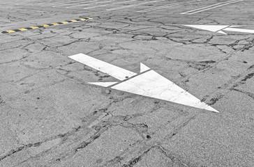 Road markings,two way white traffic arrows,speed bump.
