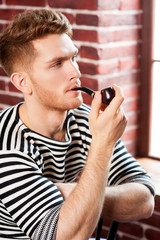 Man smoking pipe.
