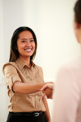 Young professional lady giving hands greeting