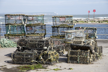 Crab and lobster pots on the quay at Mudeford Dorset England