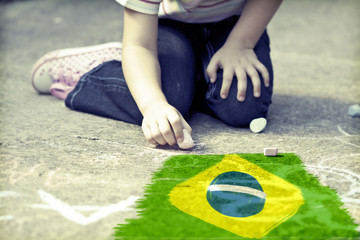 Child drawing Brazil`s flag