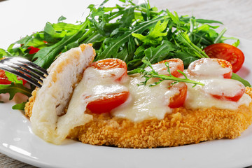 Baked chicken with mozzarella and cherry tomatoes  fillet
