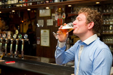 Portrait of  a men drinking beer at the bar