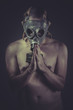 Nude man with gas mask, nuclear concept