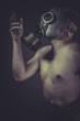 Nude man with gas mask, pollution concept protection