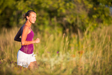 Young woman running outdoors on a lovely sunny day
