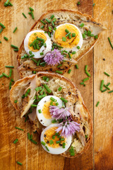 Sandwich with egg, mackerel and edible flowers of chives