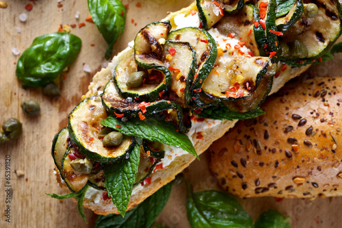 Fotobehang Snack Sandwich with grilled zucchini, goat cheese and capers