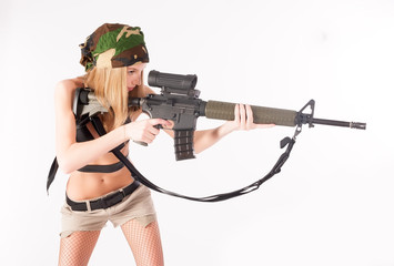 beautiful sexy blond woman with sniper rifle