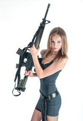 Pretty woman with gun