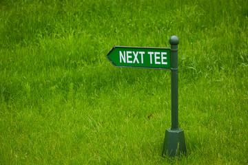 Next tee sign arrow direction golf field
