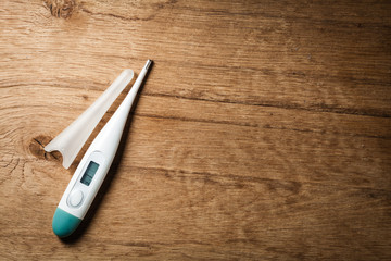 Medical background. Electronic thermometer.