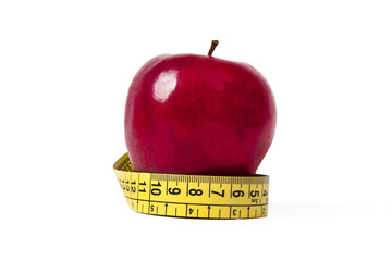 apple with tape measure, concept of healthy eating, lifestyle