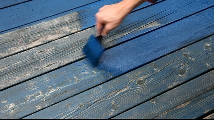 Painting in blue with wood preservative
