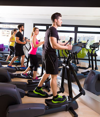 Aerobics elliptical walker trainer group at gym