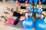 Fitball crunch training group core fitness at gym - 65395881
