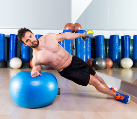 Fitball abdominal side push ups Swiss ball man