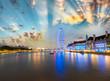 London skyline along Thames and famous London Eye wheel on a won - 65396865