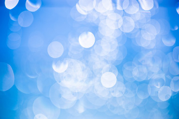 Abstract circular blue bokeh background.