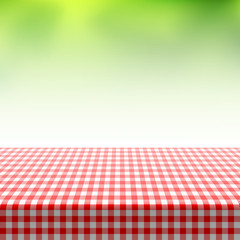 Picnic table covered with checkered tablecloth