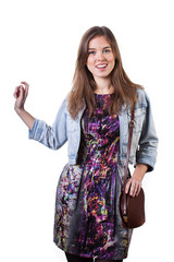 Girl wearing colorful dress and denim jacket