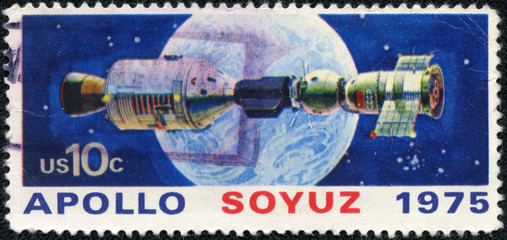 stamp printed in USA shows space satellite, apollo soyuz
