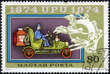 stamp printed in Hungary shows Mail coach and UPU Emblem