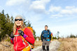 Couple walking and hiking on mountain trail