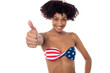 Young woman in bikini showing thumb up
