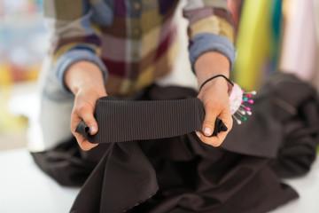 Closeup on seamstress showing fabric