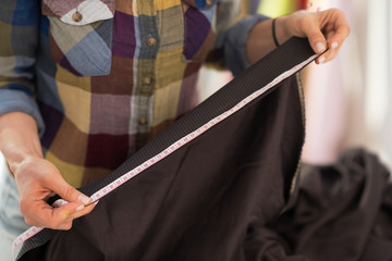 Closeup on seamstress measuring fabric