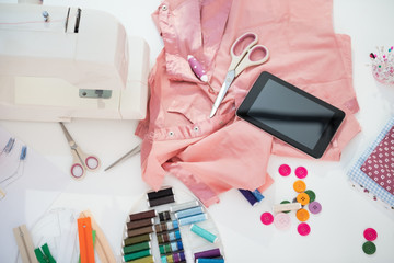 Closeup on seamstress table with tablet pc